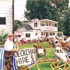 Sunshine at last for the Torquay Cricket Festival 1994! Deckchairs for hire with cricket club house in background