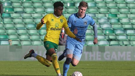 Bali Mumba of Norwich and Ben Sheaf of Coventry City in action during the FA Cup match at Carrow Roa