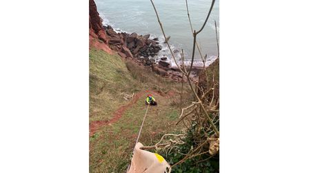 Picture of person being rescued on steep slope