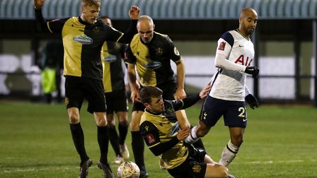 Tottenham Hotspur's Lucas Moura (right) is tackled by Marine's James Joyce during the Emirates FA Cu