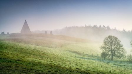 Winter mist on the Castle Howard Estate, Pyramid and Welburn village in North Yorkshire