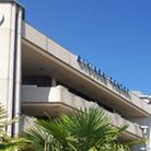 The English Riviera International Conference Centre building with a palm tree in the foreground