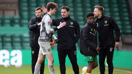 Daniel Barden of Norwich is congratulated by the coaching staff at the end of the FA Cup match at Ca