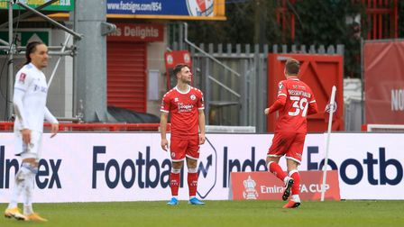 Crawley Town's Nicholas Tsaroulla celebrates scoring his side's first goal of the game during the Em