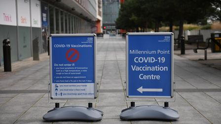 Signs outside the the NHS coronavirus vaccine centre that has been set up at Robertson House in Stev