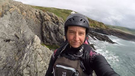 Image of coasteering guide Sue Allen in wetsuit with rocky coast backdrop, who is featured in the first episode of the new...