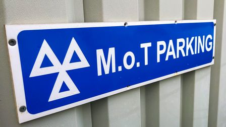 MOT parking sign blue and white grey background logo
