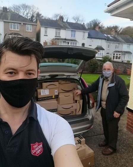 Torquay community manager Andy Bichard and Torquay Corps treasurer Fred King with one Volvo estate carload of Amazon deliveries
