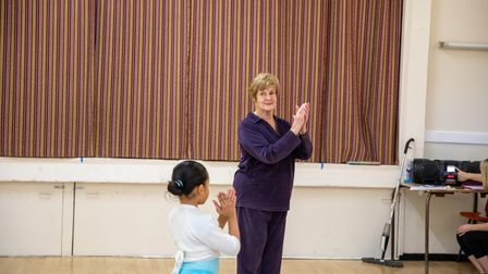 Vivien Batchelder teaches a young student ballet.