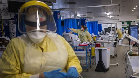 A nurse wearing PPE works on a patient in the ICU (Intensive Care Unit) in St George's Hospital in T