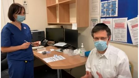 Dr Opat, from Cranwich Road Surgery in Stamford Hill, receiving a vaccine administered by Dr Cerian Choi.