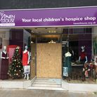 The entrance to Haven House Children's Hospice's shop in South Street, Romford is boarded up after the glass door was smashed into.