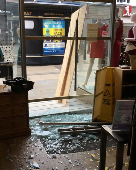 The damage done to the glass front door of Haven House Children's Hospice's shop in South Street, Romford.