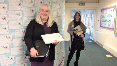 Claire Fegan, Head of School, with Caroline Curtis, Key Stage 2 Leader, holdingsome of the devices that have been donated
