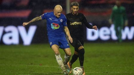 Stockport County's Sam Minihan (left) and West Ham's Said Benrahma battle for the ball