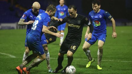 Stockport County's Ryan Croasdale (left) and West Ham's Mark Noble battle for the ball