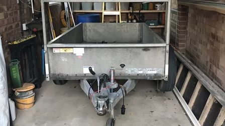 Picture shows a metal trailer in a garage