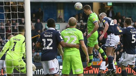 Christoph Zimmermann powers Norwich City back in front in a 3-1 win at Millwall Picture: Paul Ches
