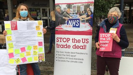 Global Justice Herts and Beds' Maryla Hart (left) and Sue Lines (right) holding banners