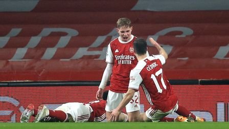 Arsenal's Emile Smith Rowe (centre) celebrates scoring his side's first goal of the game with teamma