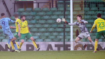 Daniel Barden of Norwich makes a save from a shot on goal by Maxime Biamou of Coventry City during t