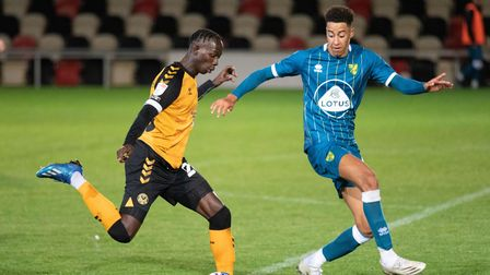 Saikou Janneh of Newport County and Jonathan Tomkinson of Norwich City U21 during the EFL Trophy mat