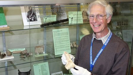 Nigel Hyman holding a pig bone from High Peak (500AD) at the Peter Orlando Hutchinson exhibit in Sid