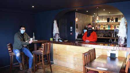 Dan Trivedi, left, and general manager, Shaun Rignall, who are serving takeaway coffee and toasties