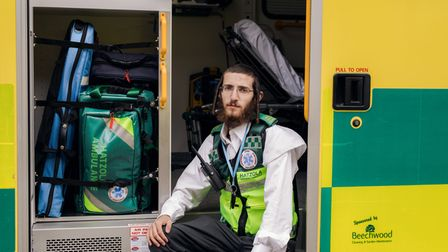 Hatzola technician Dovy Sternlicht sits in one of the ambulances at the end of a day.