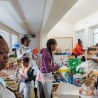 Volunteers from Hackney charity Children With Voices sort supplies at one of its food hubs.