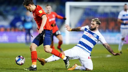 Luton Town's Tom Lockyer (left) and Queens Park Rangers' Charlie Austin battle for the ball during t