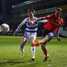 Luton Town's George Moncur (right) and Queens Park Rangers' Tom Carroll battle for the ball during t