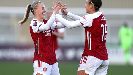 Arsenal's Beth Mead (left) celebrates scoring her side's fourth goal of the game with team-mate Cait