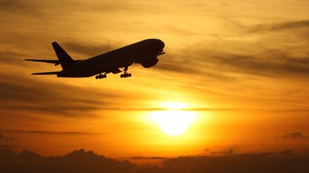 An aeroplane taking off at sunset. Photograph: Steve Parsons/PA.