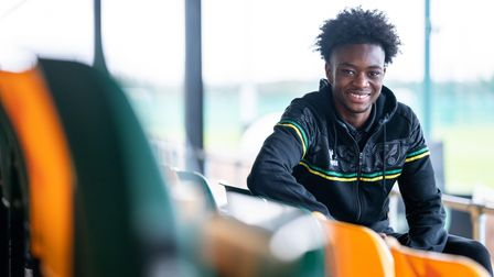 Abu Kamara signs a contract for Norwich City at the Lotus Training Ground.
