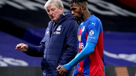 Crystal Palace manager Roy Hodgson (left) speaks to Wilfried Zaha at the end of the Premier League m