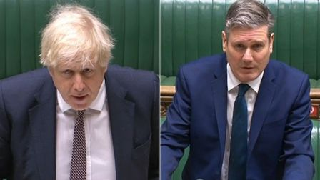 Boris Johnson (L) and Sir Keir Starmer during a session of Prime Minister's Questions (PMQs)