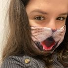 Reporter Andra Maciuca wearing a cat face mask