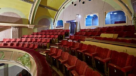 The interior of Grade II-listed Paignton Picture House with red tiered seats