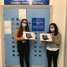 Trauma and stress clinic assistant psychologists Abbie and Noor with the tablets donated by Asda and Helpforce.