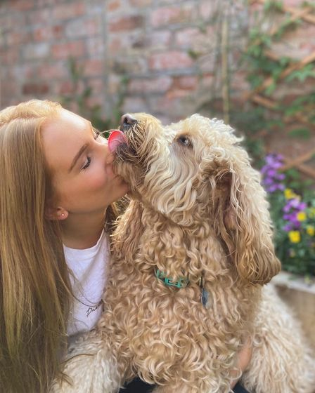 Belle Clarke and Ozzie the miniature goldendoodle
