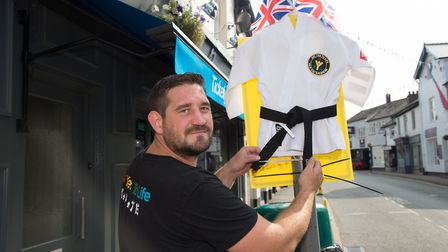 Tour of Britain passes through Ottery St Mary. Paul Batters of Say Yes to Life Karate with his jerse