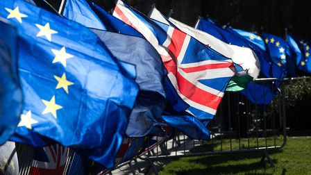 Anti-Brexit campaigners wave Union and European Union flags outside the Houses of Parliament. Photog