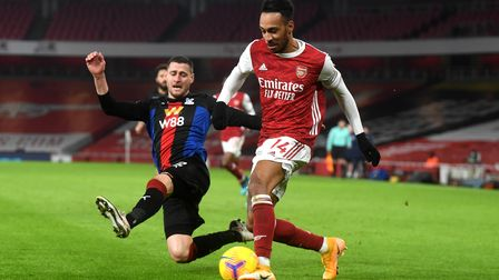 Crystal Palace's Joel Ward and Arsenal's Pierre-Emerick Aubameyang battle for the ball