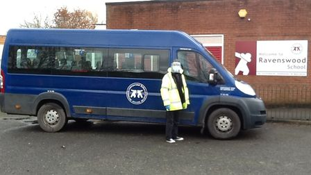Kevin in front of minibus at Ravenswood School