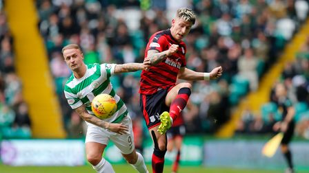 Celtic's Leigh Griffiths and Dundee's Josh Meekings battle for the ball during the Ladbrokes Scottis