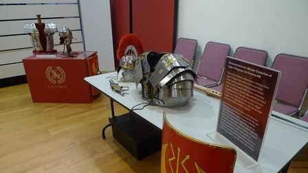 The Roman handling collection for school workshops, including a Centurion's helmet, on a table