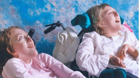 Sisters sitting in their wheelchairs