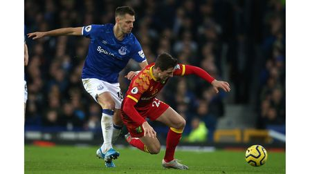 Kenny McLean of Norwich is fouled by Morgan Schneiderlin of Everton during the Premier League match