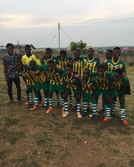 The Humble Lions from Ghana wearing a selection of the kits and boots donated by teams.